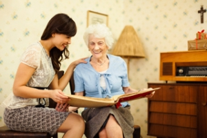 Live-In Aide Reading to Client